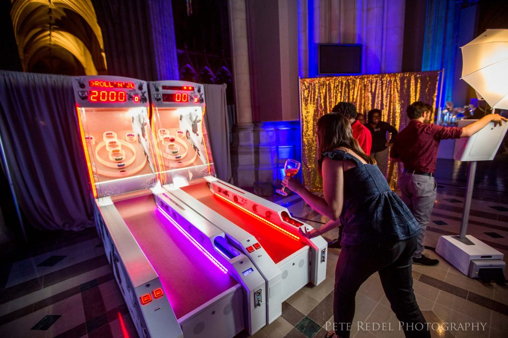 woman playing skeeball at event