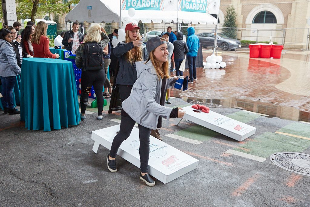 playing cornhole taste of georgetown event