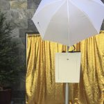 back of picture perfect photo booth outside gold backdrop
