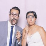 bride and groom with mustache props in photo booth