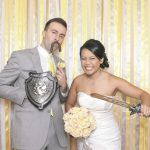 bride and groom with silly photo booth props
