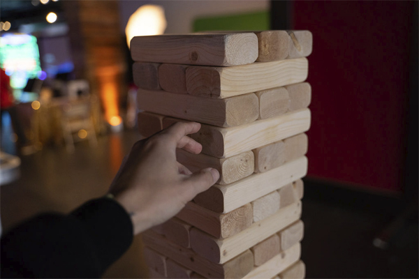 giant jenga hand reaching out to play