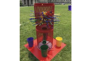 giant kerplunk game outside on grass