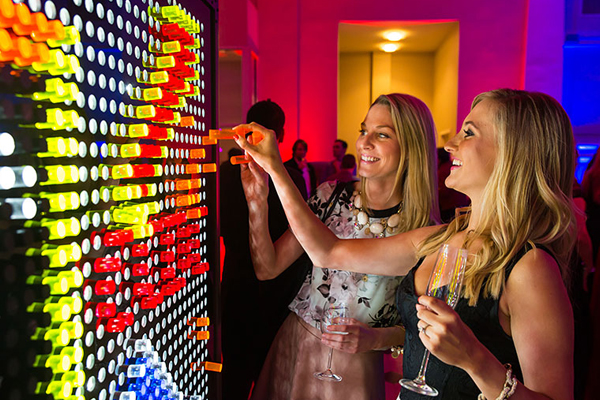 two women using the giant lite brite at the dc magazine event