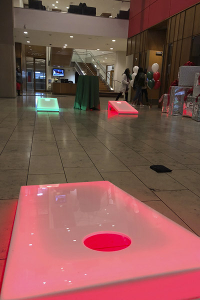 led cornhole at holiday party red and green glowing lights