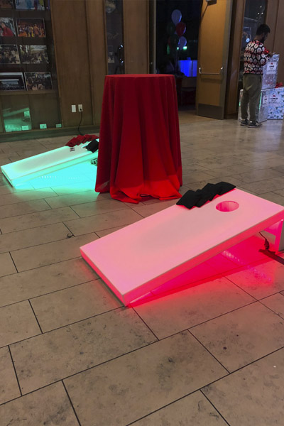 led cornhole at holiday party red and green lights 2