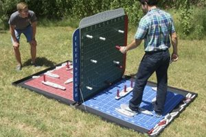 people playing giant battleship on grass outside