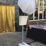 picture perfect photo booth outside gold backdrop and props